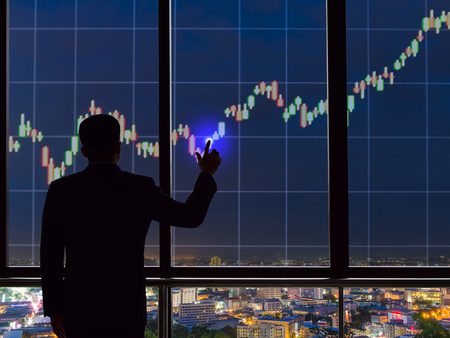 Businessmen touch screen stock exchanges and financials.
