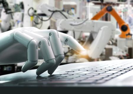 Robot concept or robot hand chatbot pressing computer keyboard enter industry