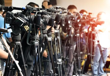 Video camera tape recording TV and journalist Фото со стока