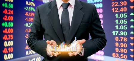 Businessmen holding bar graph on the smartphone Investment technology finance Banco de Imagens - 124531705
