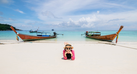 Women lie on the beach and the sea have a holiday summer relaxing and travel bright sky koh lipe thailand Banco de Imagens - 124531715