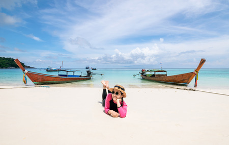 Women lie on the beach and the sea have a holiday summer relaxing and travel bright sky koh lipe thailand Banco de Imagens - 124531716
