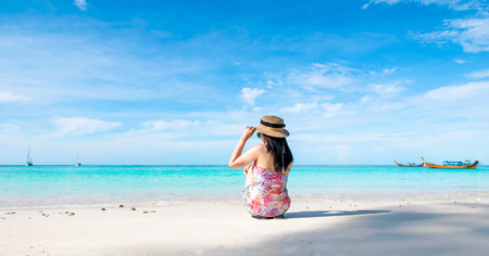 Women sitting back on the beach and sea have a holiday summer relaxing and travel bright sky koh lipe thailand Banco de Imagens