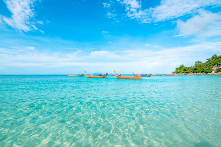 Sea and clear water beach have a holiday summer relaxing and travel bright sky koh lipe thailand Banco de Imagens - 124532007