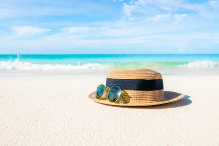 Hats and glasses placed on the beach and sea have a holiday summer relaxing and travel bright sky koh lipe thailand Banco de Imagens