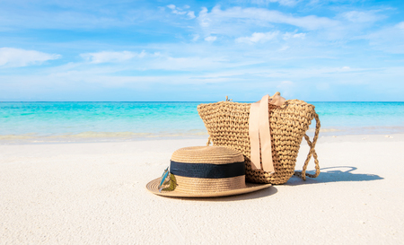 Hats and glasses placed on the beach and sea have a holiday summer relaxing and travel bright sky koh lipe thailand Reklamní fotografie