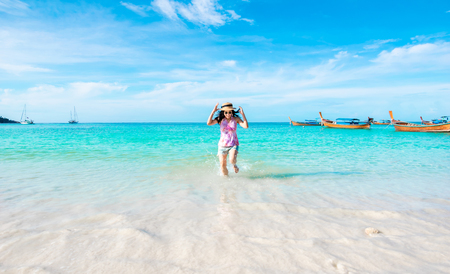 Happy woman running the beach and sea have a holiday summer relaxing and travel bright sky koh lipe thailand