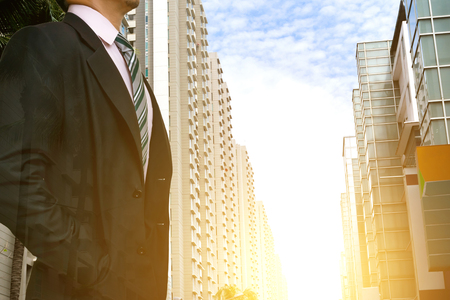 businessman leadership wearing in a city with buildings looking at city skyline at sunset the concept of modern life business