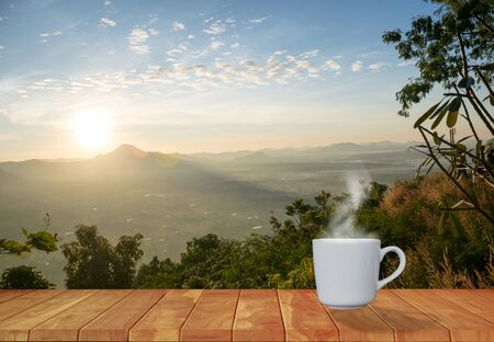 Coffee cup red with morning sunshine mountain view Stock Photo