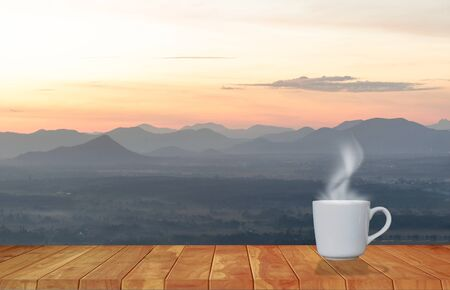 Coffee cup red with morning sunshine mountain view Banco de Imagens