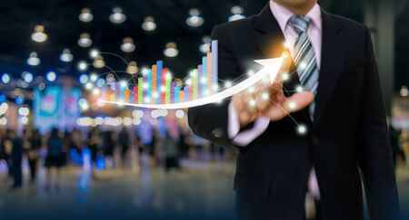 businessman pointing graph and arrow concept development to success growing annual revenue growth