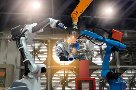 Control automation robot arms the production of factory parts engine manufacturing industry robots and mechanical arm