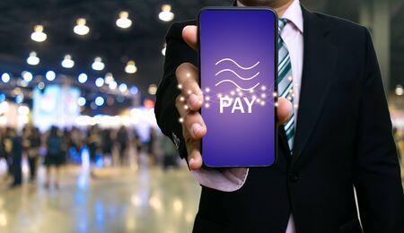 Businessman show smartphone Libra coin blockchain technology