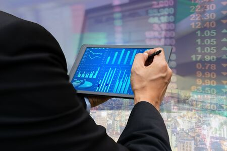 Technology business touch screen tablet stock market graph viewing