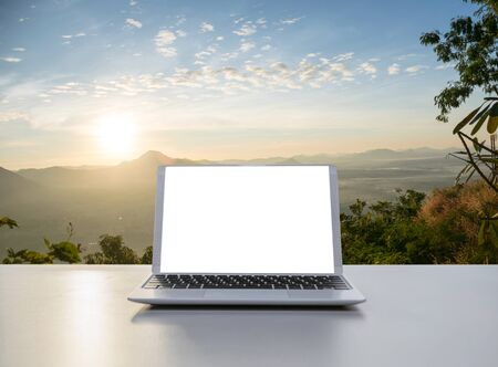 Notebook Laptop in the office The background nature and mountains Banco de Imagens