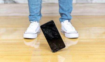 People fall smartphone on the floor broken screen Stock fotó