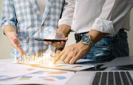 Business team work analyzing charts network technology world the desk notebook on wood table Idea presentation. Stock fotó