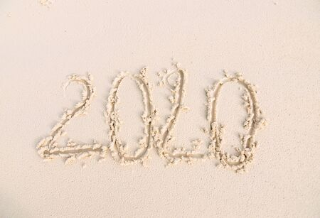 Happy New Year 2020 on the sand and beach