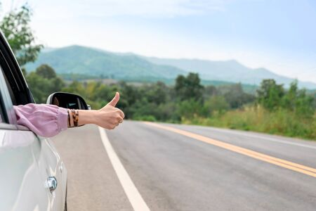 Woman driving on the road Travel by car relax