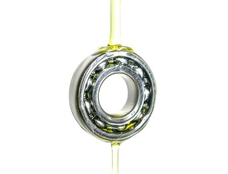 Gear and bearing industry in lubricant oiling a white background Standard-Bild