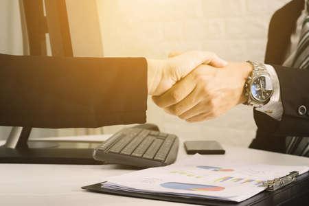 business men analyze graphs and check sales growth. Foto de archivo