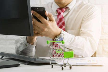Business people check E-Commerce Online market and sales Foto de archivo