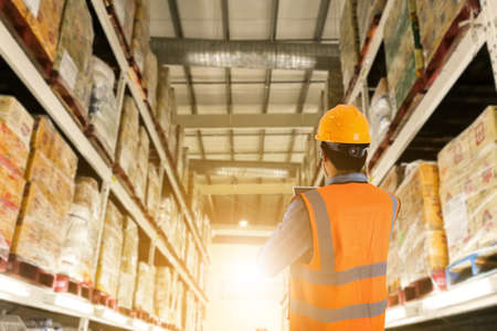 Manager in warehouse business check stock items wholesale industry logistic and export concept . Foto de archivo - 151673817