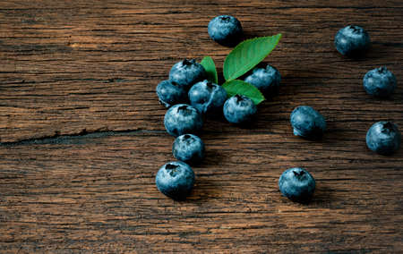 Blueberry fruit on the old wooden floor