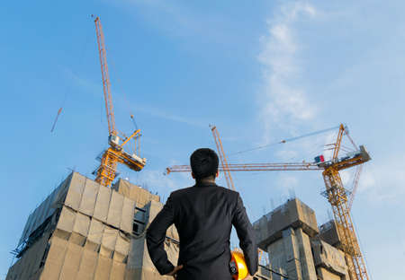 Building construction supervision a engineer and buildings 스톡 콘텐츠