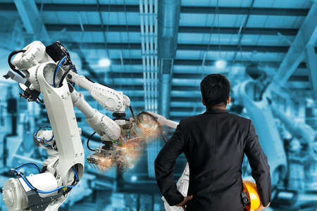 Industrial robot control the engineer in factory 스톡 콘텐츠 - 155579398