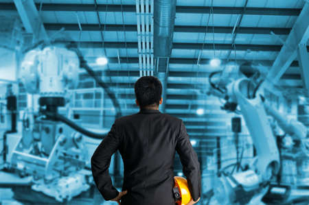 Industrial robot control the engineer in factory