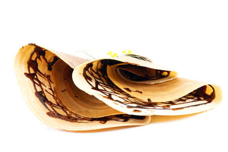 Crepe with and chocolate on a white background