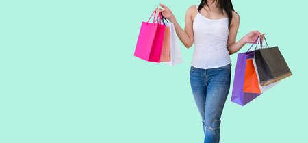 Woman carrying paper bags walking shopping