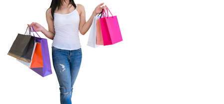 Woman carrying paper bags walking shopping white background