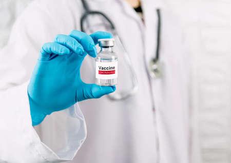 Doctor holding vaccine bottle coronavirus and medical in the hospital