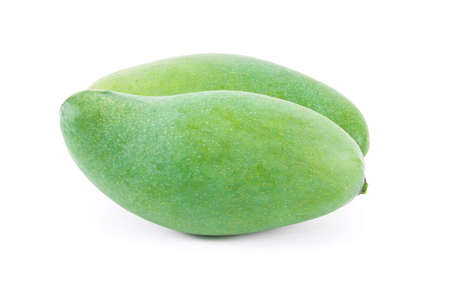 A raw mango fruit on a white background