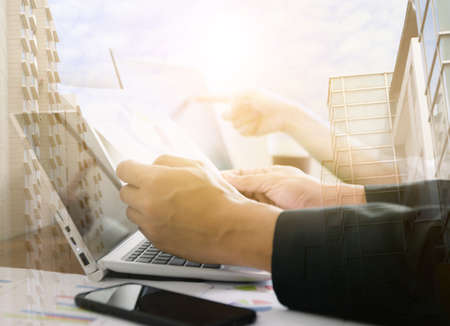 Business working in office of success with digital tablet laptop compute of double exposure image