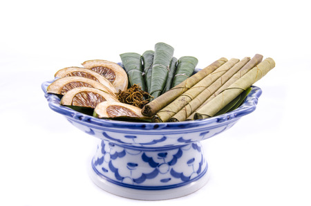 Areca nut, betel nut chewed with the leaf is mild stimulant on white background photo