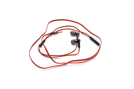 red earphones isolated on white background photo
