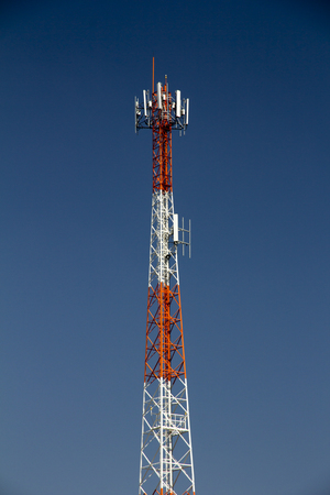 Radio tower with the blue sky background Stock Photo