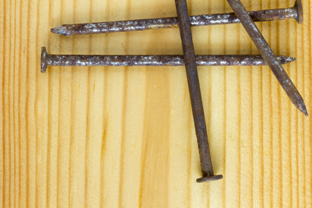 Close up texture of old rusty nails, Rusty nails on a wooden table