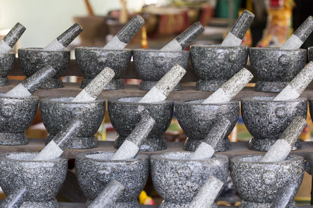 The group of Stone mortar and pestle for sale at local market. Chonburi Province, Thailand.