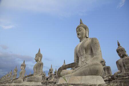 Buddha face in blue sky background, Buddha statue in Thailand, Buddha Statue.