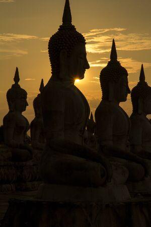 Big buddha statue in sunset background, Buddha statue in Thailand, art of religion concept Banco de Imagens