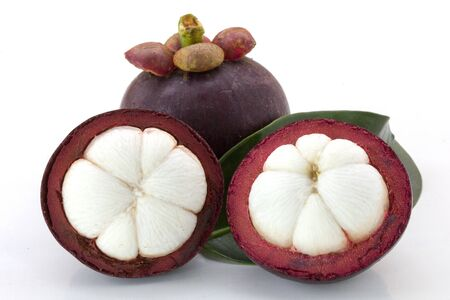 Ripe mangosteens (Garcinia mangostana) or half mangosteen with green leaves isolated on the white background, mangosteen queen.