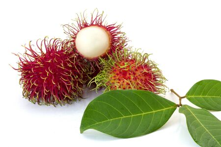 Fresh Rambutan with green leaves isolated on white background,Thailand. Imagens