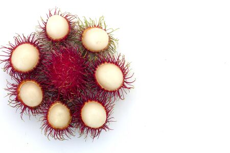 Fresh Rambutan with green leaves isolated on white background,Thailand. Banco de Imagens