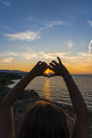 Silhouette hands at the sunset