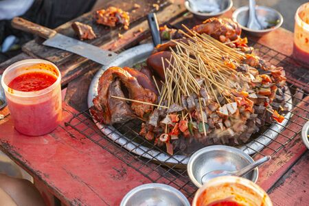 Myanmar street food, stewed pork cut into small pieces and put it on the stick for sell