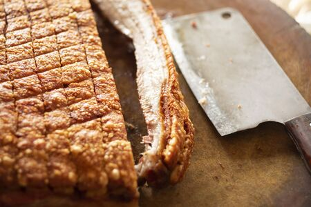 crispy pork with chinese knife placed on wooden chopping block Stok Fotoğraf